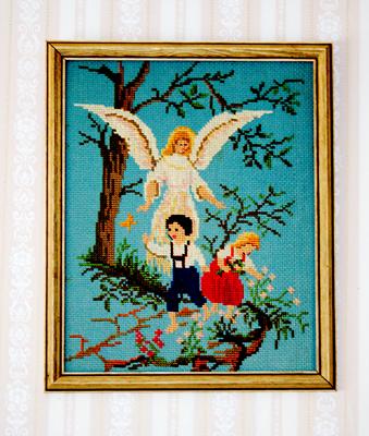 Tavla av två barn vid ett stup och en skyddsängel.